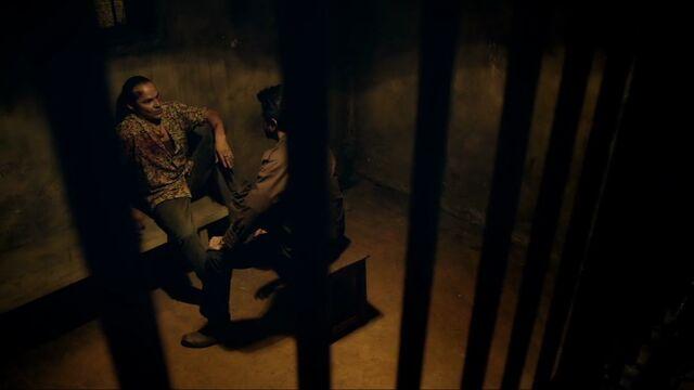 File:In1x05 Parvez in cell.jpg