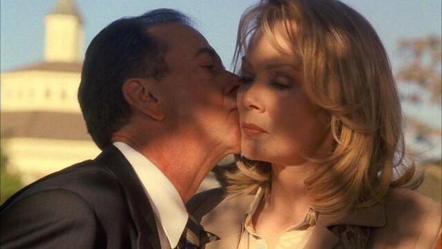 File:5x06-logan-martha-kiss.jpg