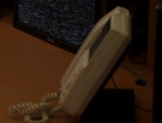 File:5x07 downstairs phone.jpg