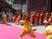 Demonstrating Kung Fu at Daxiangguo Monestary, Kaifeng, Henan