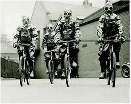 Bicycling gas masked guys