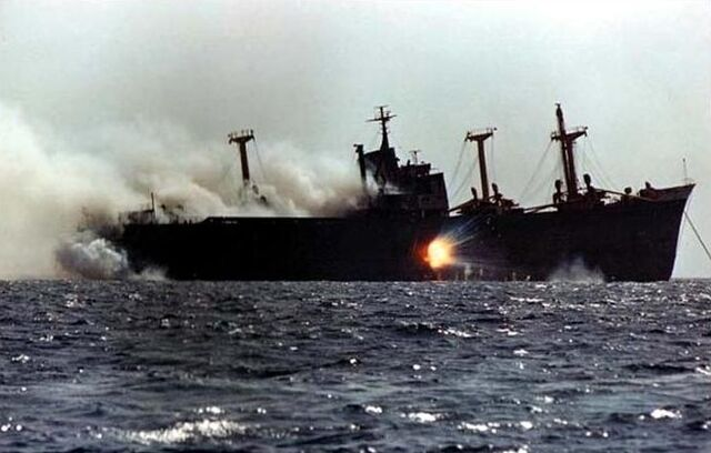 File:Cargo Ship under attack in Tanker war.JPG