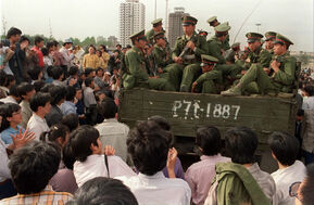 Demonstrators pla truck