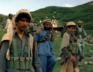 Afghan Muja crossing from Saohol Sar pass in Durand border region of Pakistan, August 1985