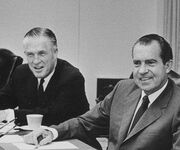 Nixon and Romney in a cabinet meeting
