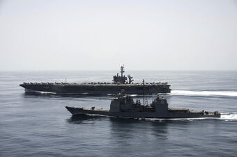 USS Theodore Roosevelt (CVN-71) and the USS Normandy (CG-60)