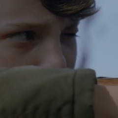 Young Hank Foxx aiming at a witch