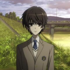 Kouichi in his Tokyo school uniform for his aunt's funeral.