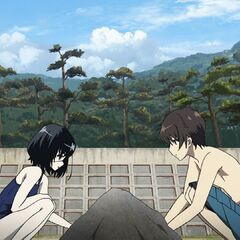 Mei and Kouichi play in the sand.