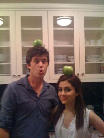 File:Ariana and a friend with apples on their heads.jpg