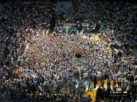 809417-Carolina fans storm the court after their victory-Chapel Hill