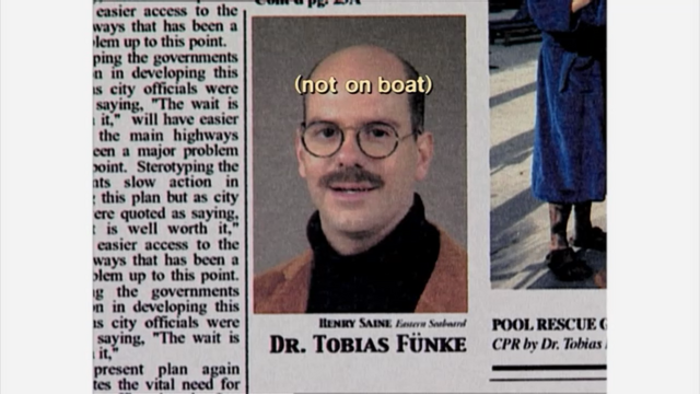 File:1x01 Tobias newspaper closeup.png