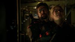 Slade holds Felicity hostage