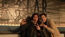 Cisco Ramon and Barry Allen taking selfies with the S.T.A.R. Laboratories sign.png
