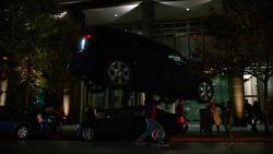 Mon-El stops a car