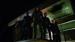 Team Arrow overlook the panic at an outdoor shopping mall