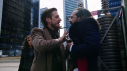 Rip Hunter holds the knife in to Vandal Savage
