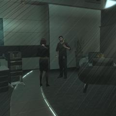 梅兰妮在她的办公室中与奥利维耶交谈