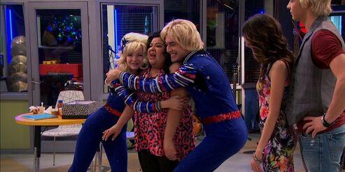 Trish hugged by Billie & Bobbie