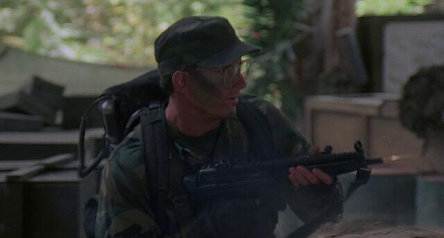 File:Hawkins fires MP5.jpg
