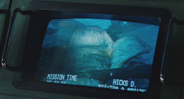 File:Hicks looks at Egg with shotgun on monitor.jpg