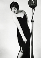 Mae Questel dressed up as Betty Boop, has to hide one withered arm