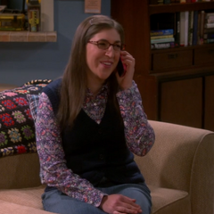 Amy giggling while speaking to Dave on the phone.