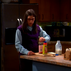 Amy making Sheldon strawberry Quik to calm him down.