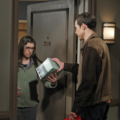 Sheldon gets Amy a Star Trek DVD set to watch.