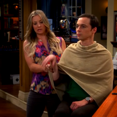 Penny using Sheldon as a ventriloquist's dummy.