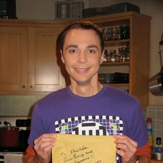 Sheldon holds Leonard Nimoy's napkin, signature and DNA.