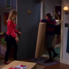 Amy enters with Penny's gift.