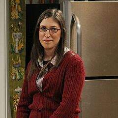 Amy smiles at Sheldon.