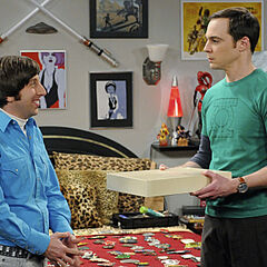 Howard hands Sheldon the maid outfit.