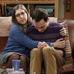 Amy comforting an upset Sheldon.
