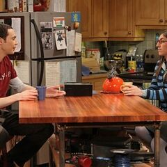 Amy and Sheldon having tea together.