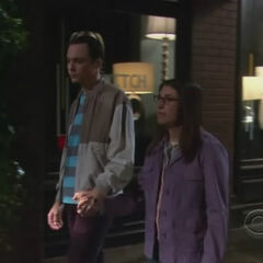 Amy experimenting with holding Sheldon's hand.