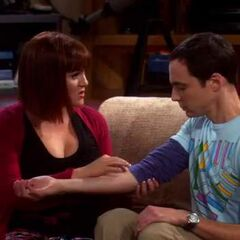 Dr. Stephanie gives Sheldon a cooties shot.
