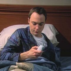 Sheldon sick in bed.