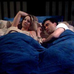 Sheldon wakes Leonard and Penny.
