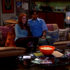 Raj watching a scary movie with Emily.