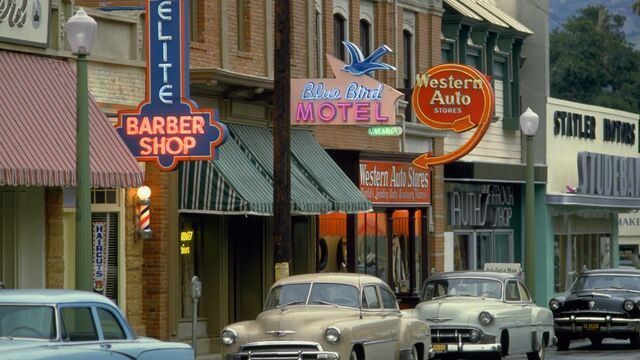 File:Elite Barber Shop - Blue Bird Motel - Western Auto Stores - Ruth's Frock Shop - Statler Studebaker.jpg