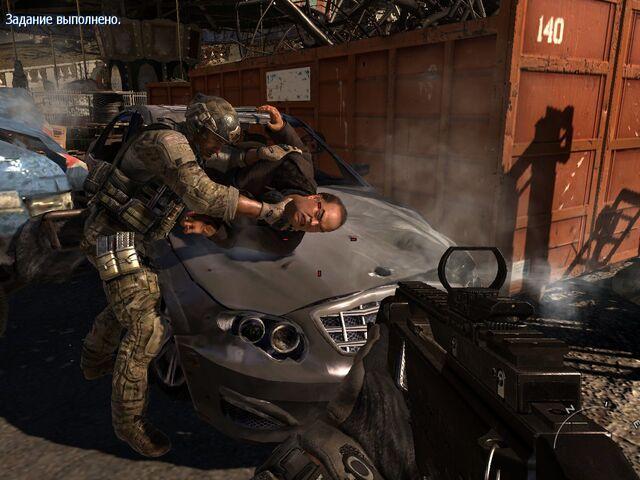 File:Sandman torturing Volk MW3.jpg