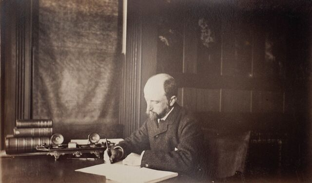File:Henry Adams seated at desk in dark coat, writing, photograph by Marian Hooper Adams, 1883.jpg
