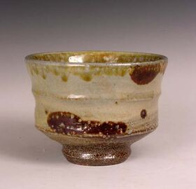 A contemporary salt glazed bowl with iron painted decoration.