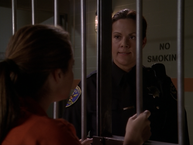 File:8x03FemaleCop.png