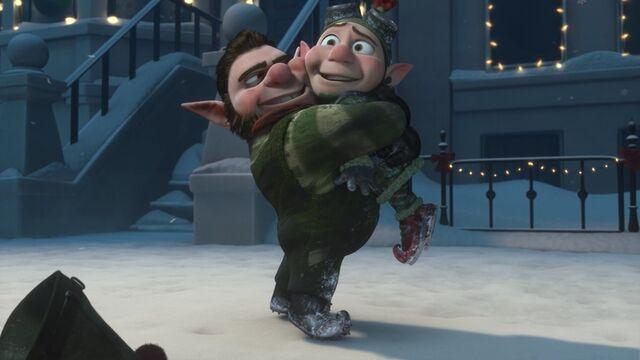 File:Noel hugging Wayne.jpg