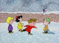 Kids throw snowballs at can