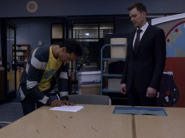 File:5x01-Abed signs Jeff.jpg