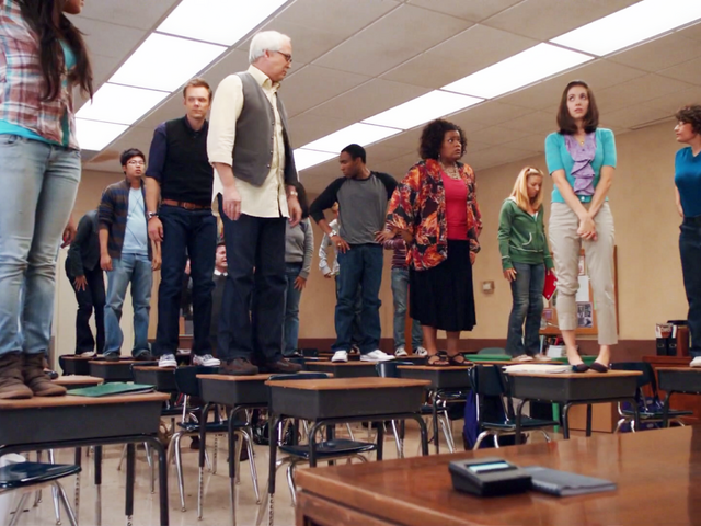 File:ITF Living in the moment by standing on desks.png